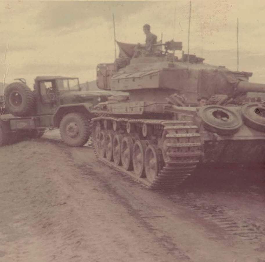 A centurion tank pulling the low loader out of the bog 1969.