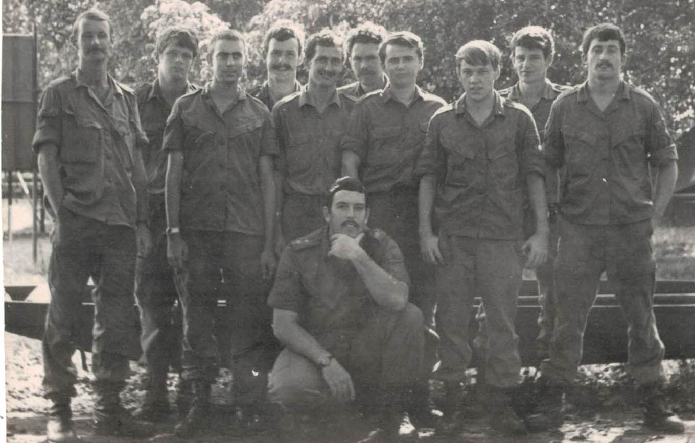This is the 1971 HQ Group with me as Troop SGT on the left.  John Pritchard who was Admin Officer LT is squatting.