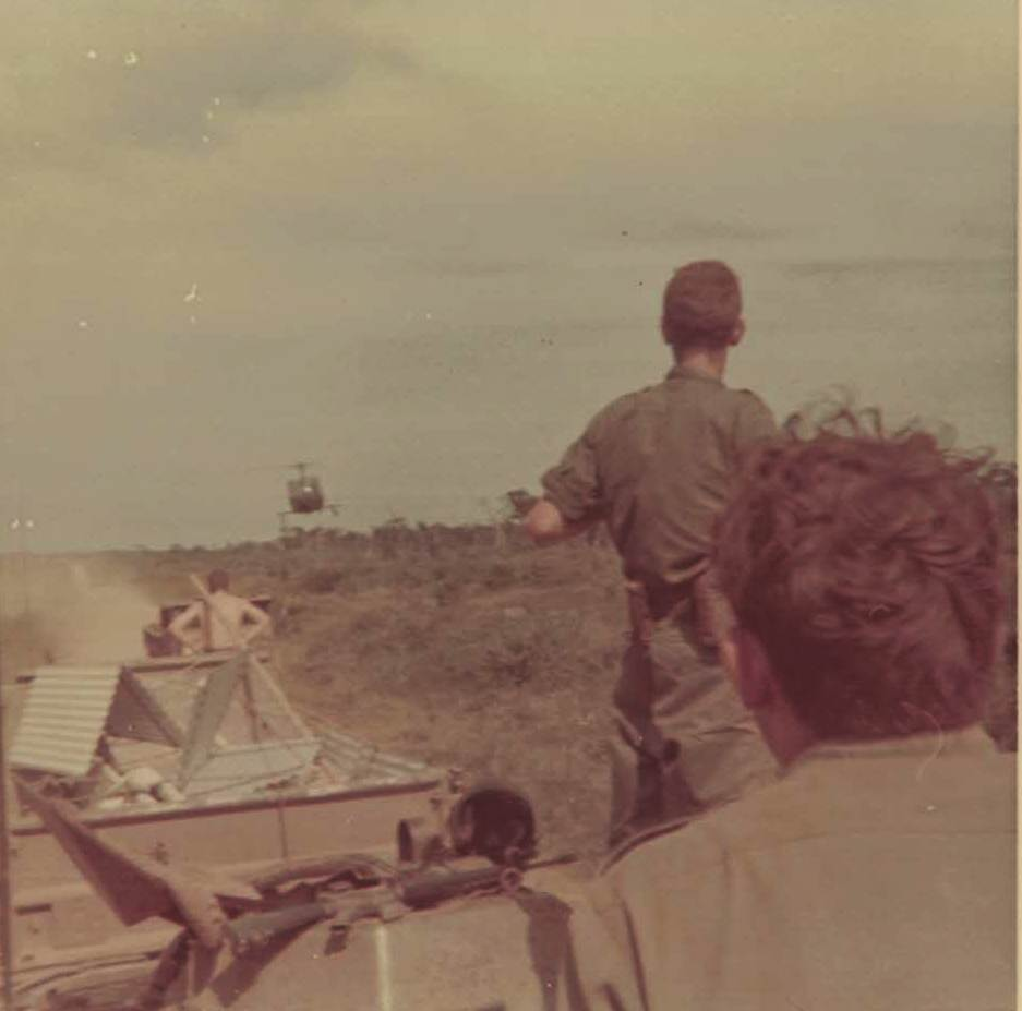 This pic shows a very low flying helicopter.  We are on an APC convoy.  Year is 1969 but can't recall just where.  Somewhere in Phuoc Tuy Province
