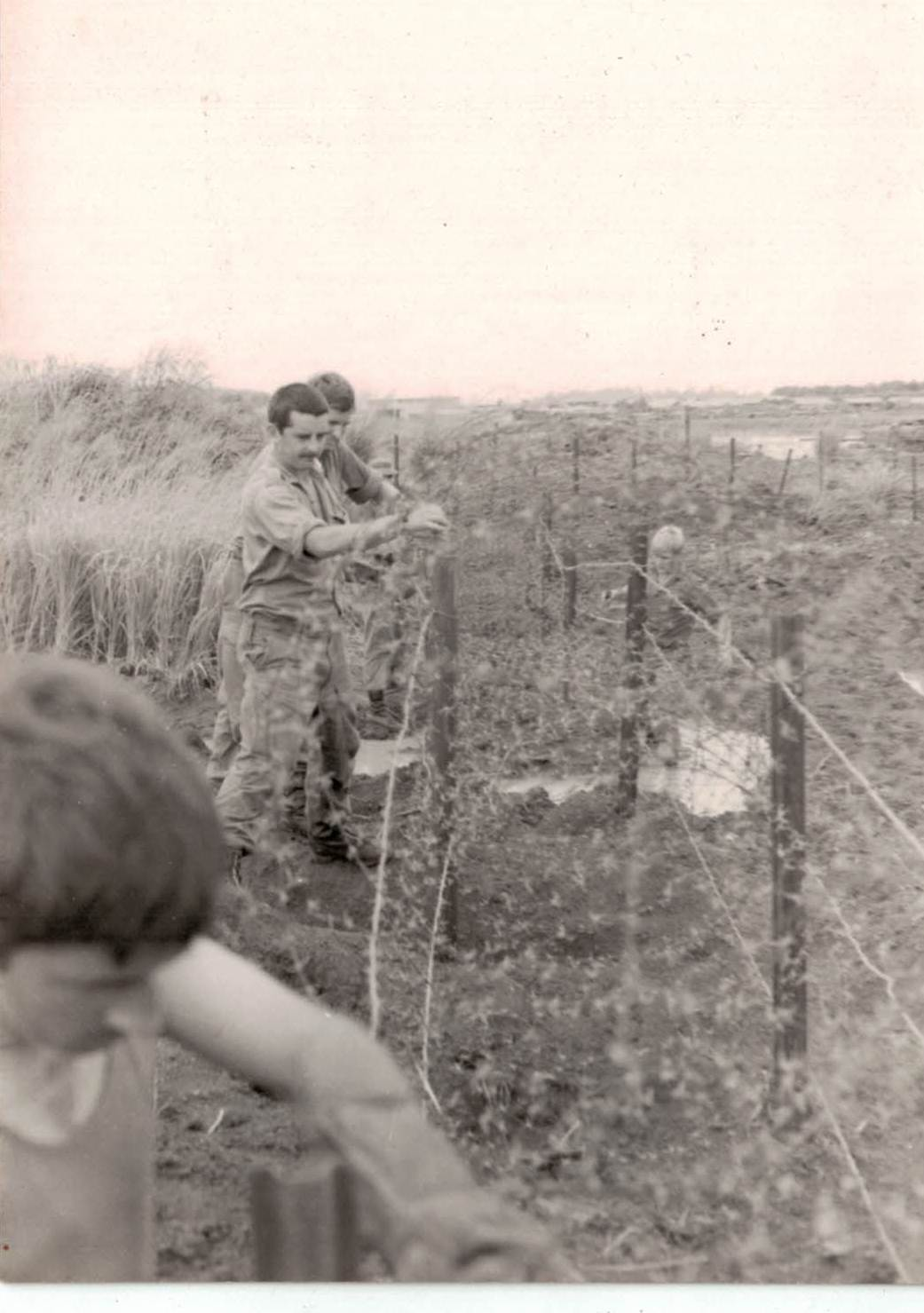 Sappers of 1 FD SQN GP repairing perimeter wire at Nui Dat 1971.