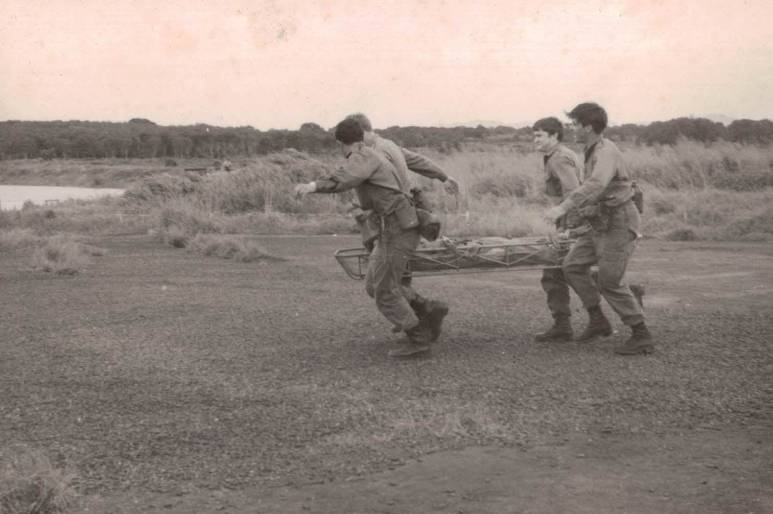 Members of 1 FD SQN GP practicing medical evacuation.  Rowes Lagoon in background – 1971.