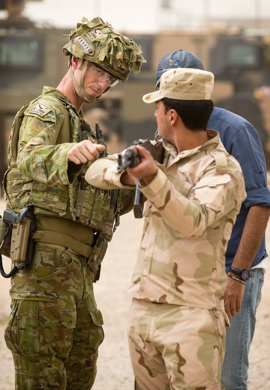 CAPT Josh Watson from 1 Fd Sqn instructs basic marksmanship principles to an Iraqi Army soldier on Range 4 at Taji Military Complex.