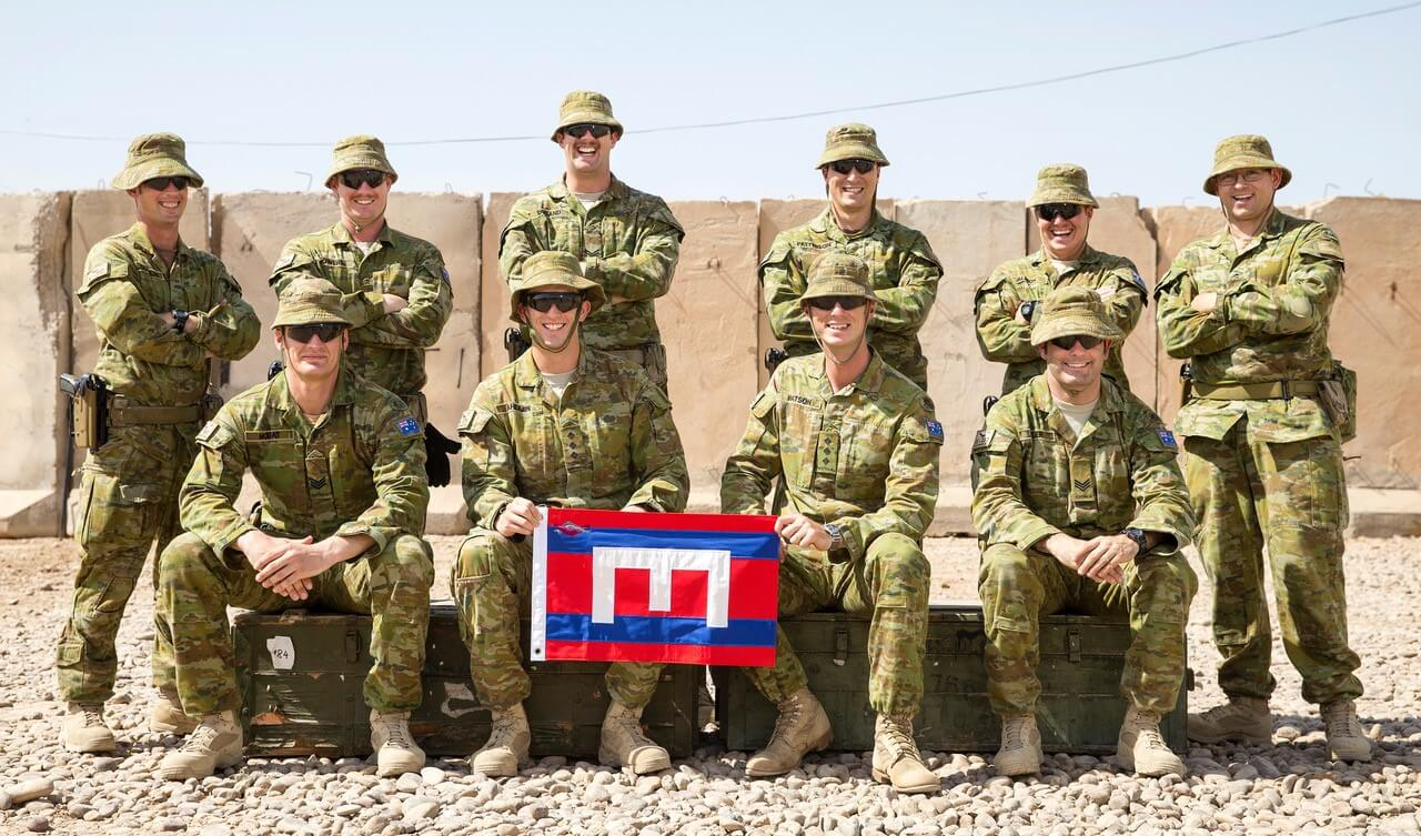 Members from 1 CER deployed with Task Group Taji III pose for a photo marking the 101st Anniversary of the Waterloo Dinner.