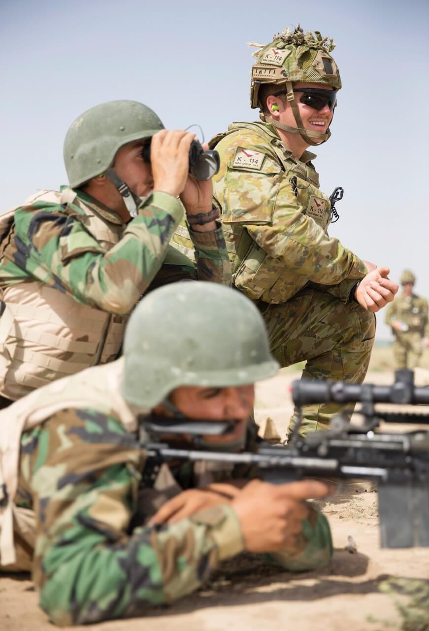 CPL Lindsay Albion observes his Iraqi Rangers during a marksmanship range at Camp Taji, Iraq.