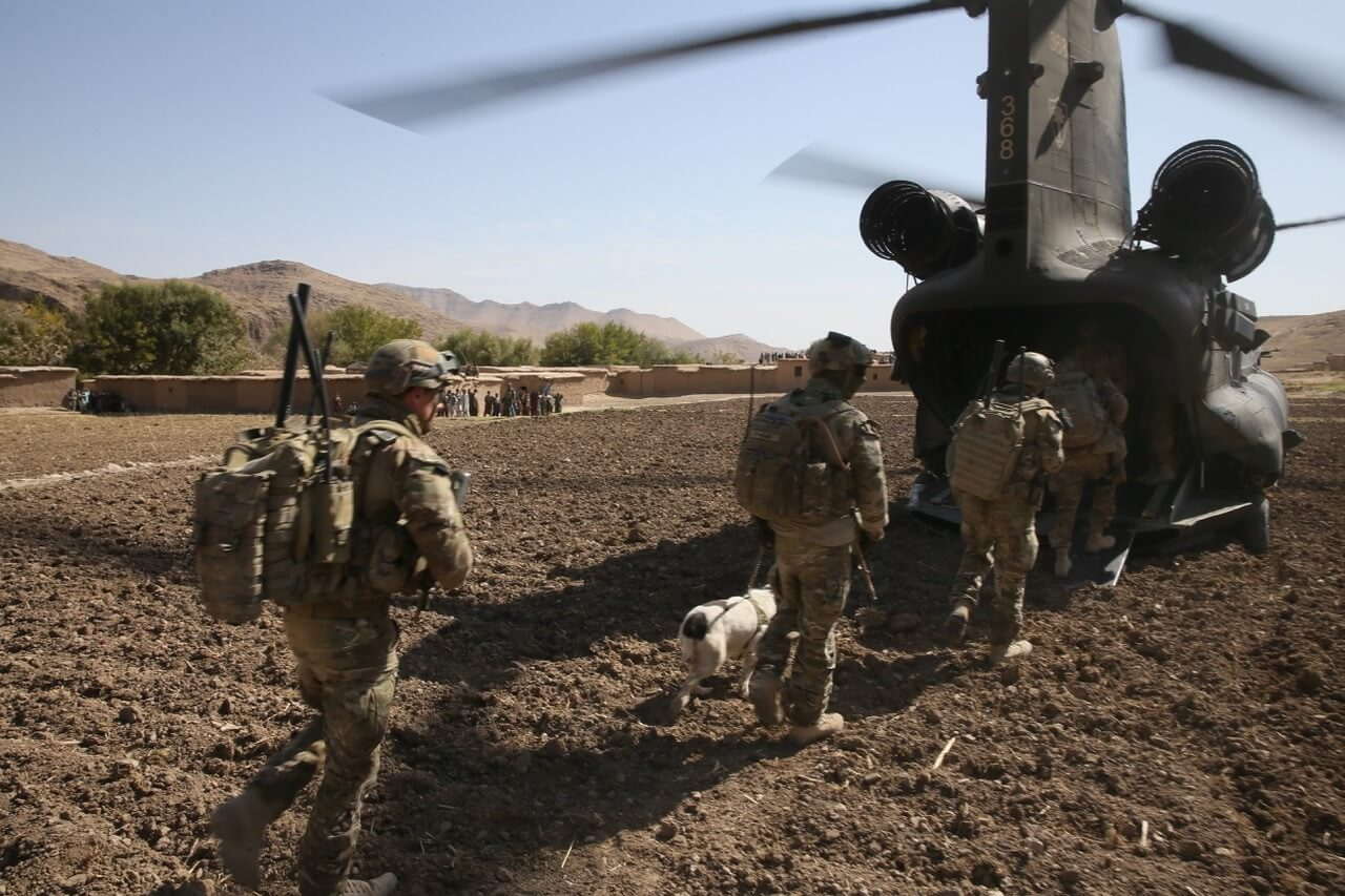 5 Section, 2 Troop and an EDD Team from 23 Support Squadron board a US CH-47 Chinook after a task in Afghanistan in 2013.