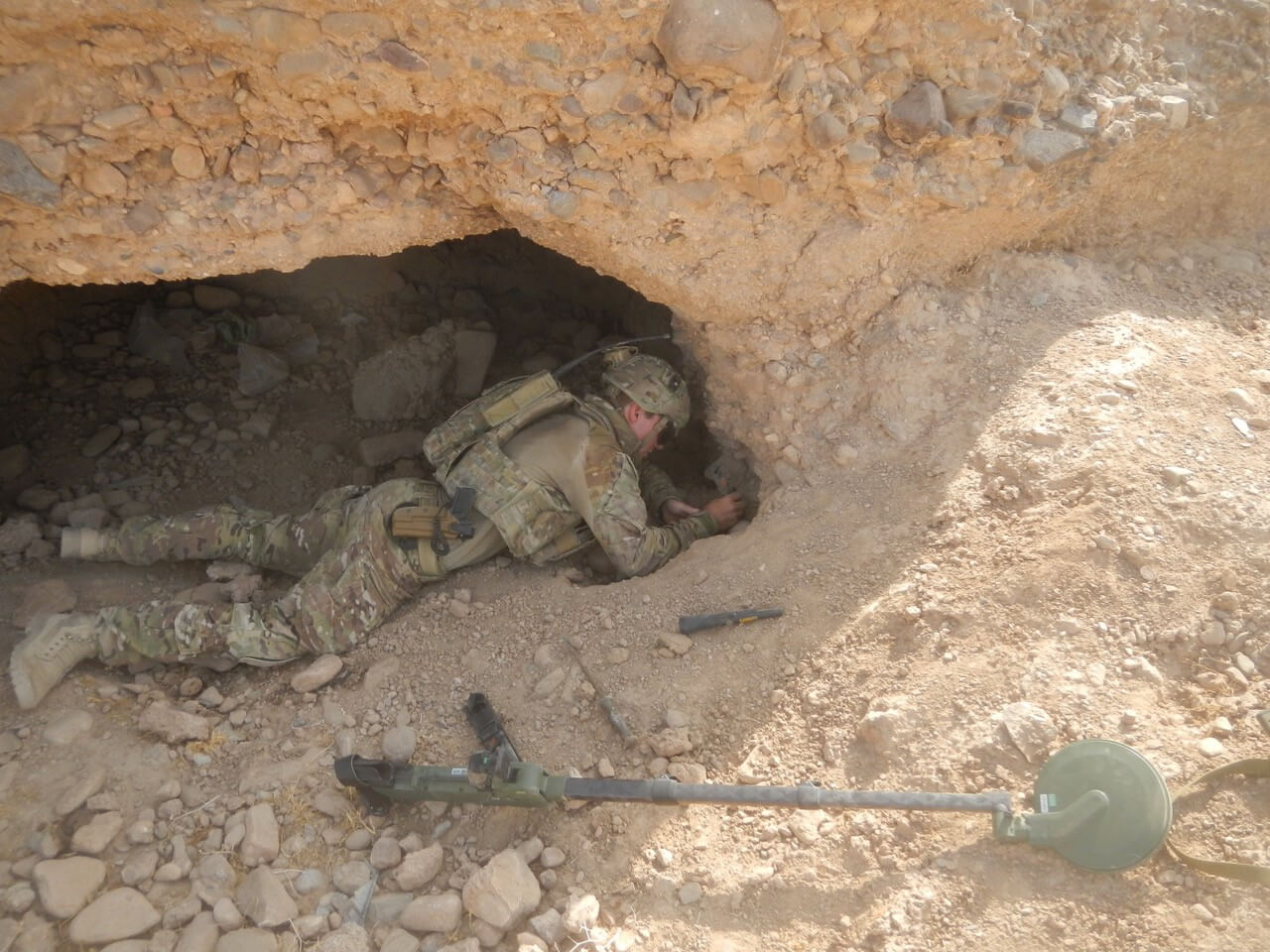 SPR Damien Gower, 5 Section, 2 Troop exploiting a detection  in Uruzgan Province in 2013.