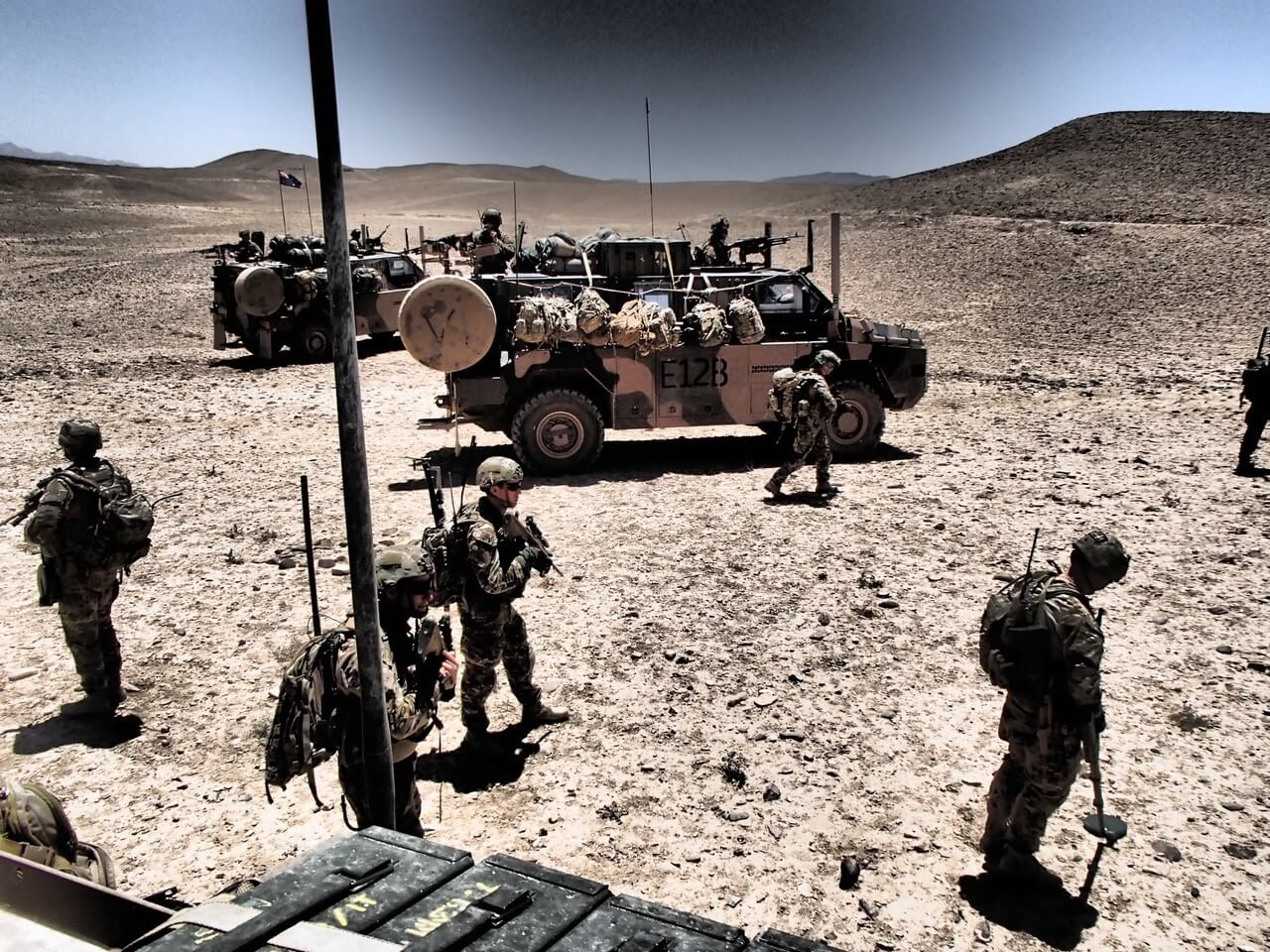 5 Section, 2 Troop and LT Matthew Scott (2 TP COMD) during a 107mm Rocket point of origin exploitation in Afghanistan, 2013.