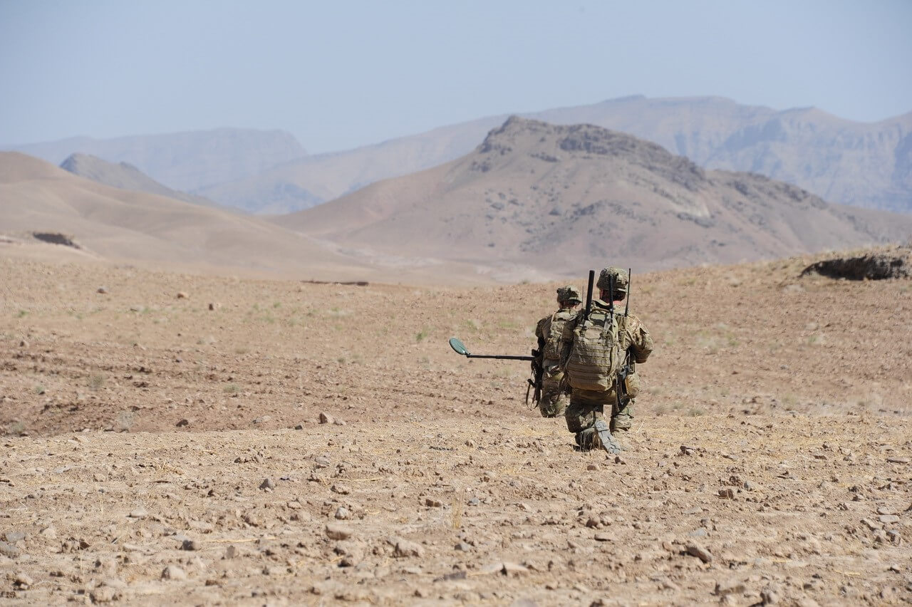 SPR Cassidy Burger and SPR Lindsey Albion during a search task in Uruzgan Province, 2013.