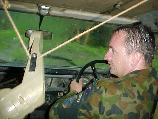 SGT Adam Moss navigating his Land Rover 110 during a monsoonal down pour.